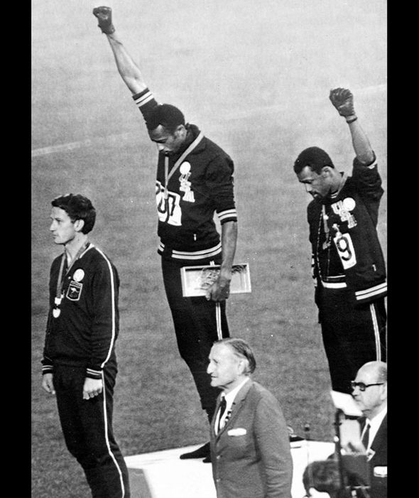 Tommie Smith and John Carlos give the Black Panther salute in response to the anthem at the 1968 Olympics